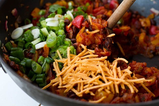 Spread 1/2 cup of enchilada sauce over the bottom of the dish. Stir in ...